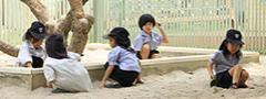 Children playing in sand box at St. Andrews Sathorn International School Bangkok